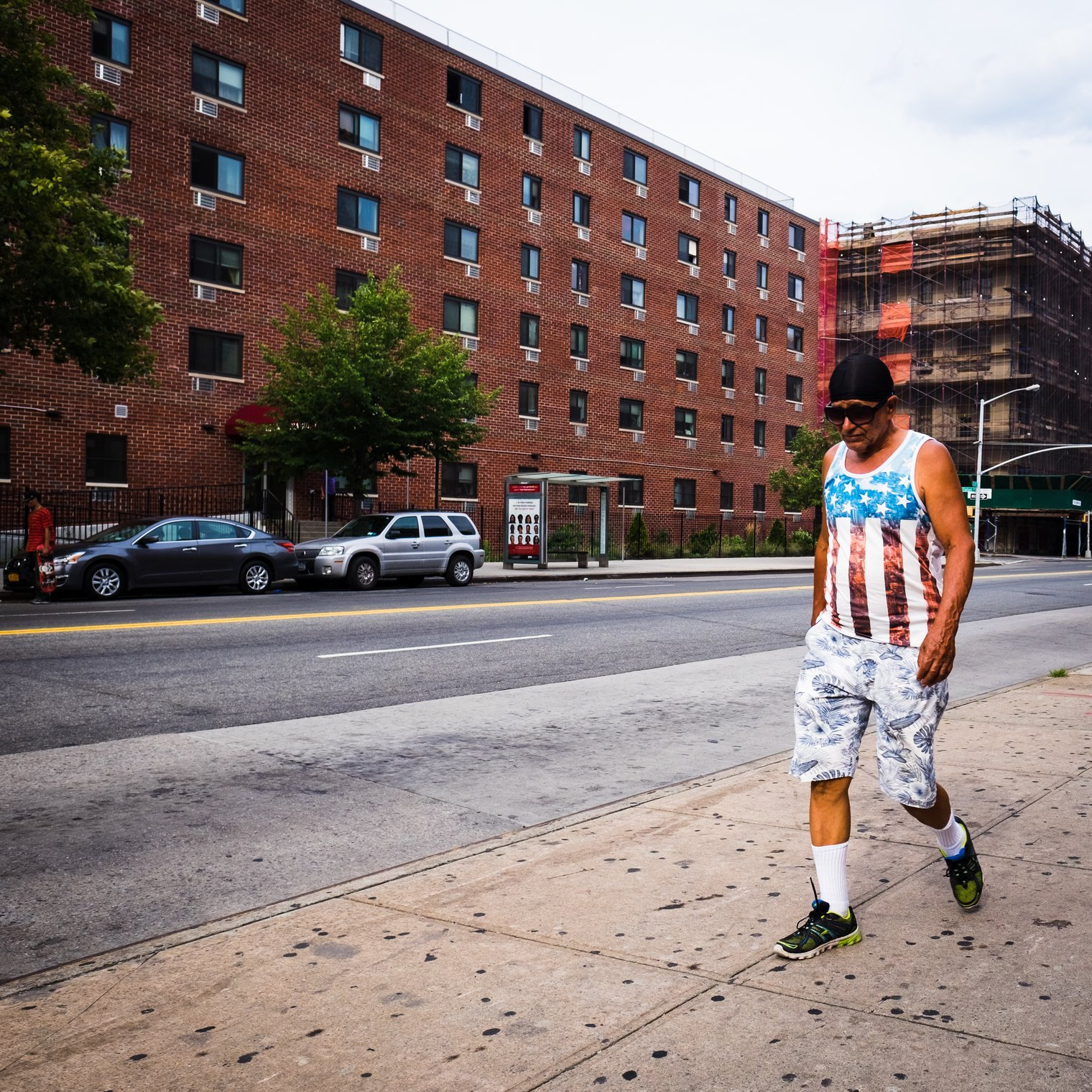 A man with an american flag shirt in the Bronx