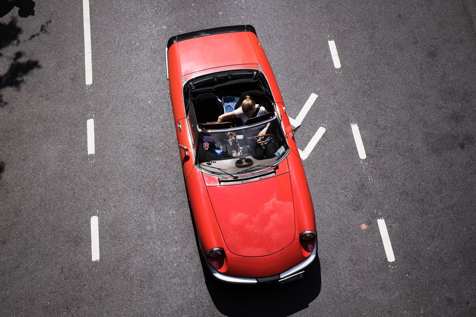 A red vintage convertible from above